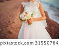 Wedding bouquet in hands of the bride 31550764