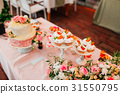 Cupcakes on a wedding table 31550795