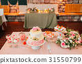 White wedding cake with flowers 31550799