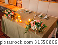 Flower compositions on the wedding table in rustic 31550809