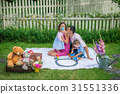 A couple sitting with the children 31551336