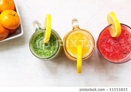 Three smoothies on a white wooden background 31553835