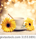 Coffee cup with yellow gerberas 31553891