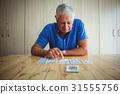 Senior man pointing at a card 31555756