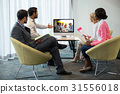 Business people looking at a screen during a video conference 31556018