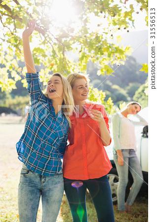 Beautiful women having a fun in park 31556513