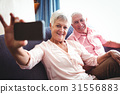 Smiling senior couple taking a selfie 31556883