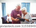Senior people looking at a digital tablet 31556949