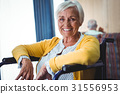 Smiling senior woman on a wheelchair 31556953