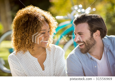 Couple smiling in park 31556969