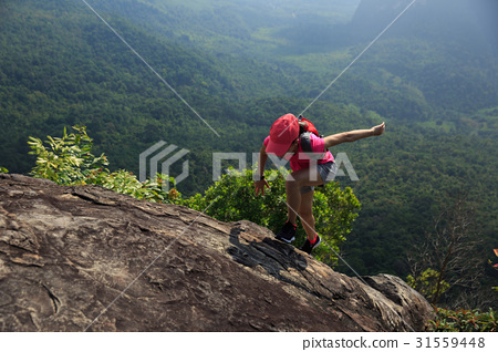 Young woman trail runner running at mountain top 31559448
