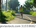 Young fitness woman running at morningforest trail 31559682