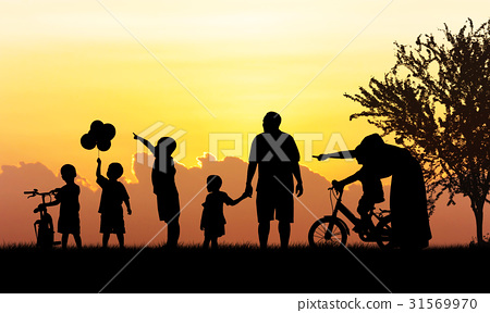 Silhouette of Happy family playing in field  31569970