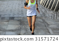 young woman running upstairs on stone stairs 31571724