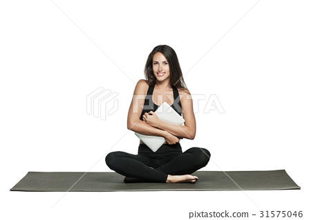 Young woman in sporty outfit holds her laptop 31575046
