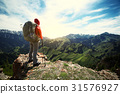 young woman hiker hiking on mountain top 31576927