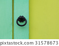 Metal antiques style door handle on colorful panel 31578673