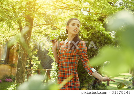 Italian fashion woman in sunny garden 31579245