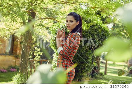 Italian fashion woman in sunny garden 31579246