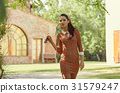 Italian fashion woman in sunny garden 31579247
