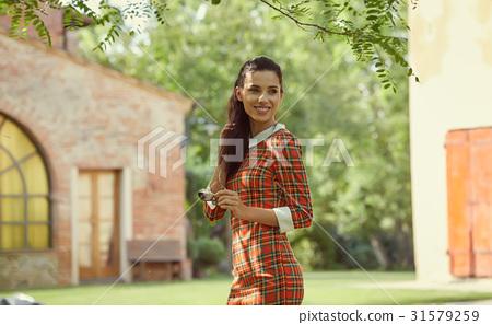 Italian fashion woman in sunny garden 31579259