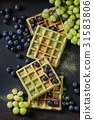 Green waffles with grapes 31583806