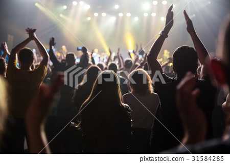 Crowd at concert and blurred stage lights . 31584285