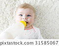 Cute adorable ewborn baby girl holding nursing 31585067