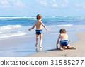 Two kid boys running on ocean beach in Florida 31585277