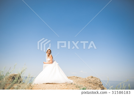 Romantic beautiful bride in white dress posing on 31586183