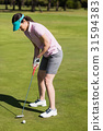 Full length side view of woman playing golf 31594383