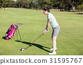 Side view of woman playing golf 31595767