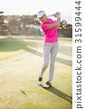 Sportswoman playing golf 31599444