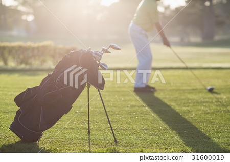 Golf bag with man in background 31600019