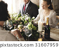 Bride and Groom Having Meal with Friends at Wedding Reception 31607959