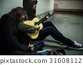 Homeless Couple Man Playing Guitar Asking For Money Donation 31608112