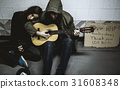 Homeless Couple Man Playing Guitar Asking For Money Donation 31608348