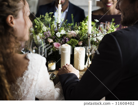 Bride and Groom Holding Hands Each Other on Wedding Reception 31608402