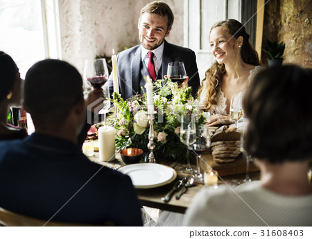Bride and Groom Clinging Wineglasses with Friends on Wedding Reception 31608403