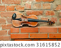 vintage violin on empty red brick wall 31615852