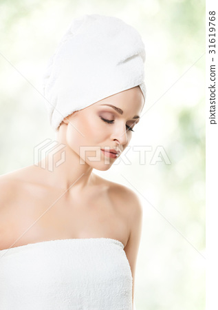 Young woman in a towel after taking a bath 31619768