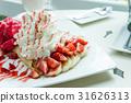 ice cream strawberry crepe dessert on white dish 31626313