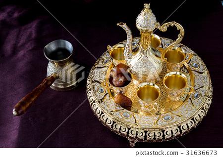 traditional golden Arabic coffee set 31636673