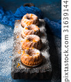 Bundt cakes on dark background and serving board 31639144