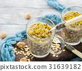 Chia oat pudding with quinoa, banana, pistachio 31639182