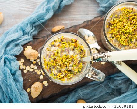 Chia oat pudding with quinoa, banana, pistachio 31639183