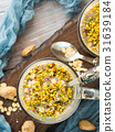 Chia oat pudding with quinoa, banana, pistachio 31639184