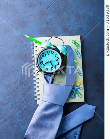Alarm clock and businessman's accessories 31639189