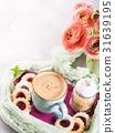 Mug of coffee cookies and flowers 31639195