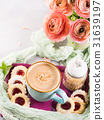 Mug of coffee cookies and flowers 31639197